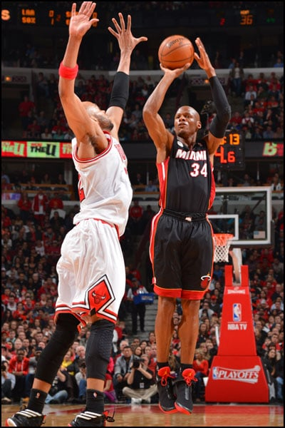 Ray Allen takes a shot over Taj Gibson of the Chicago Bulls