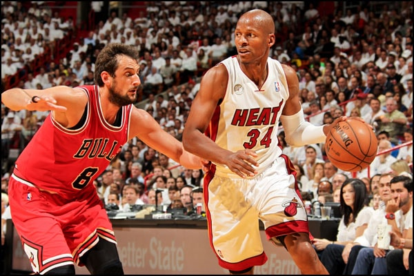 Ray Allen dribbles around Marco Belinelli of the Chicago Bulls