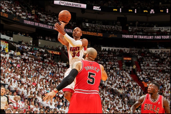 Ray Allen puts up a floater over Carlos Boozer
