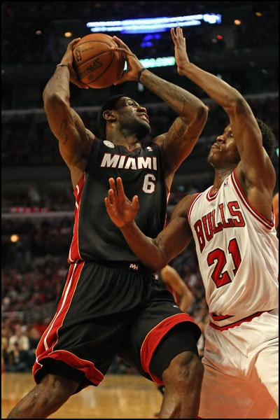 LeBron James posts up against Jimmy Butler of the Chicago Bulls