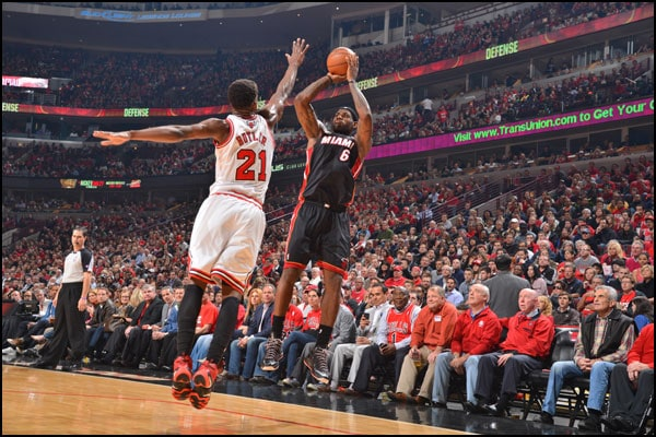 LeBron James shoots over Jimmy Butler of the Chicago Bulls