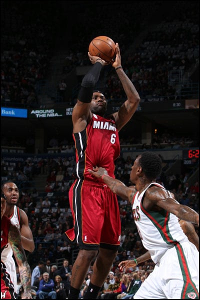 LeBron James shoots over Larry Sanders of the Milwaukee Bucks
