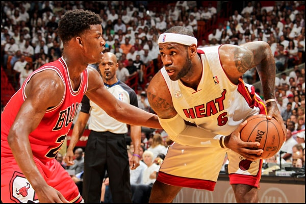 LeBron James protects the ball from Jimmy Butler of the Chicago Bulls