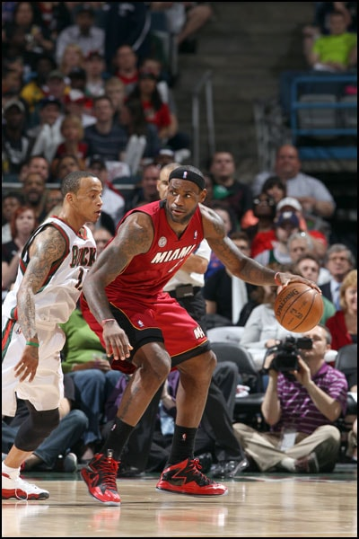 LeBron James posts up against Monta Ellis of the Milwaukee Bucks