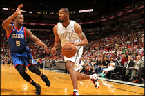 Rashard Lewis drives to the basket against Arnett Moultrie of the76ers