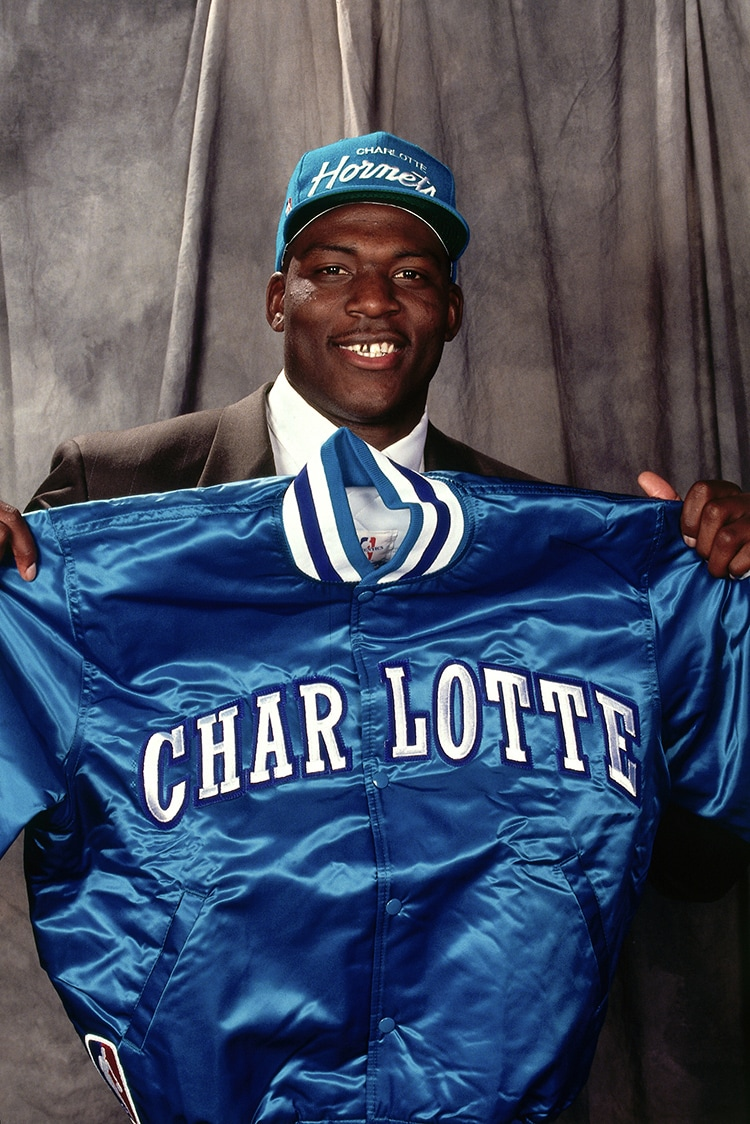 NEW YORK, NY - 1991: Rookie Larry Johnson #2 of the Charlotte Hornets holds up a Hornets jacket during the 1991 NBA Draft at Madison Square Garden in New York, New York.(NBAE Getty Images)