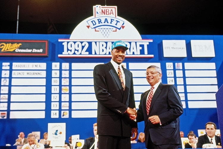 PORTLAND, OR - JUNE 24: Alonzo Mourning shakes hands with NBA Commissioner David Stern after being selected number two overall by the Charlotte Hornets during the 1992 NBA Draft on June 24, 1992(NBAE Getty Images)