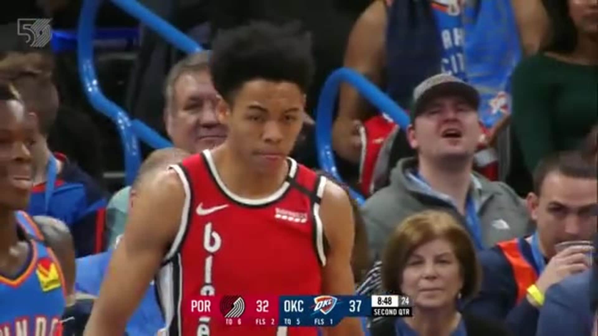 Anfernee Simons finishes in the paint and gets fouled in the process