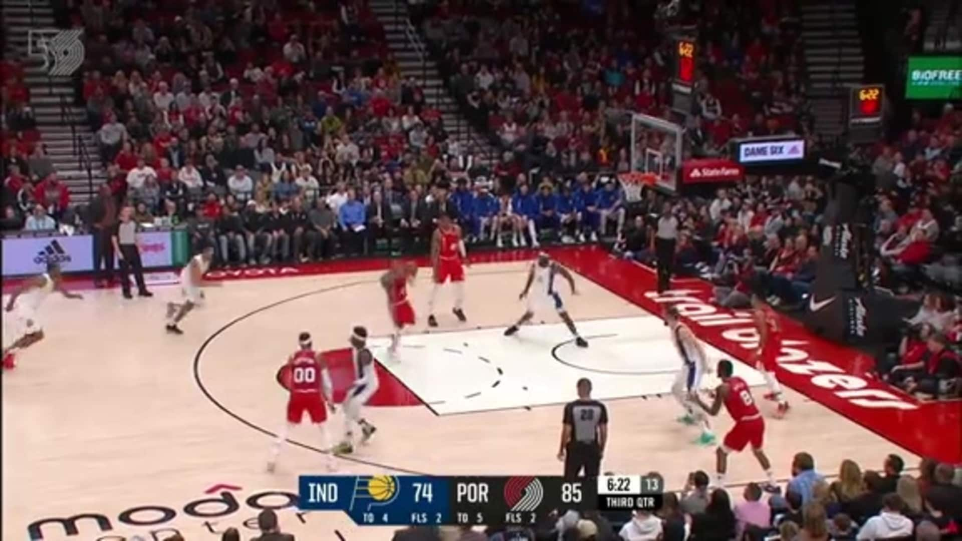 Dame goes behind the back to Hassan for the dunk