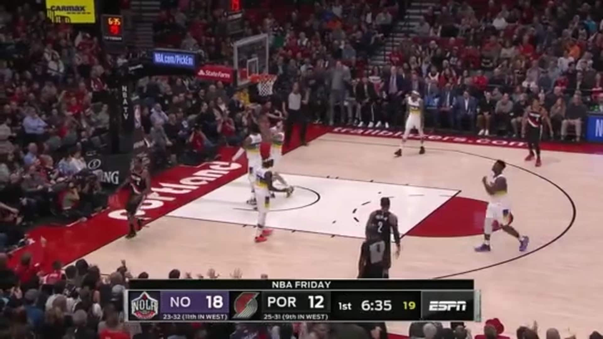 Trevor Ariza finishes on the fast break through contact