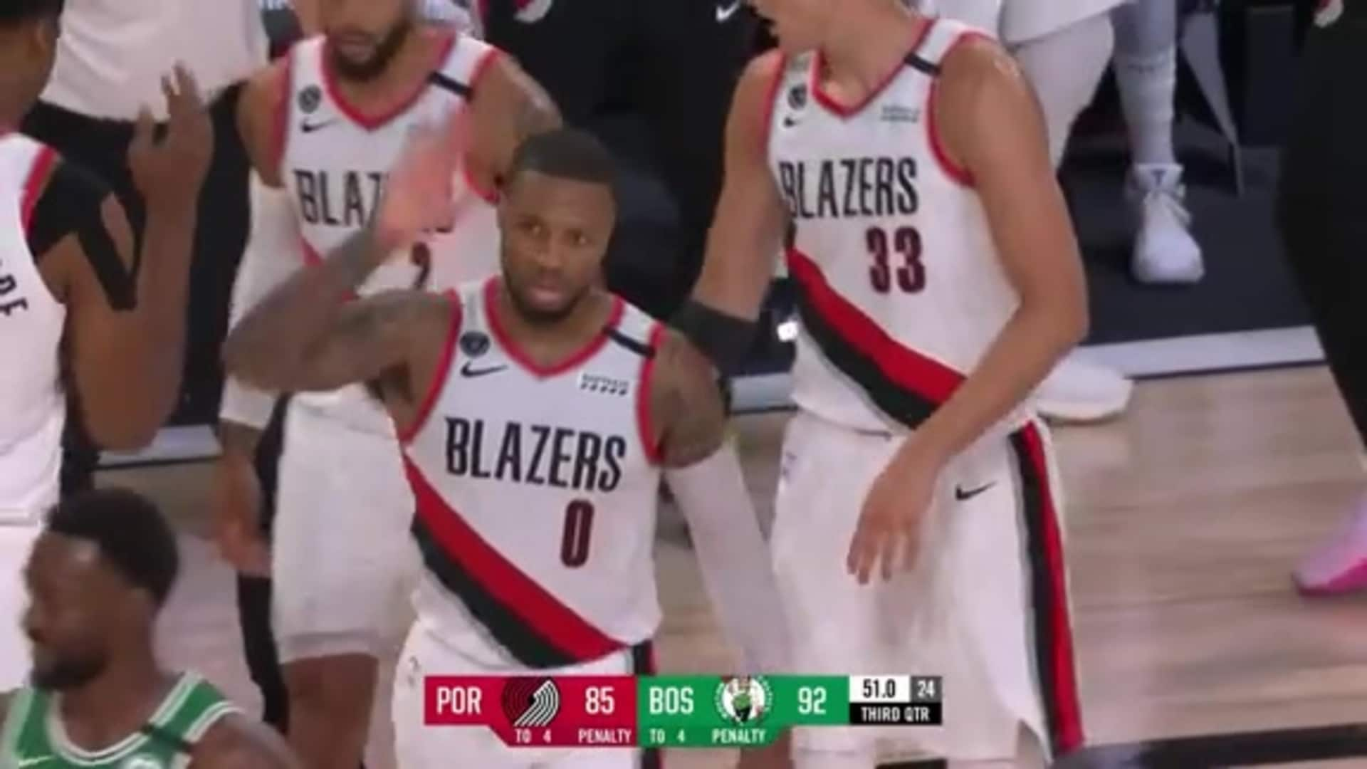 Damian Lillard hits an unbelievable shot from the logo while fouled