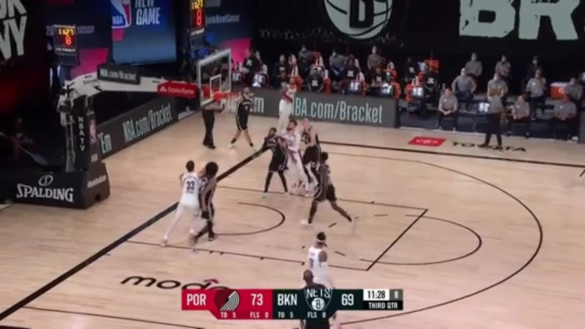 The defender can't believe this Lillard shot went in