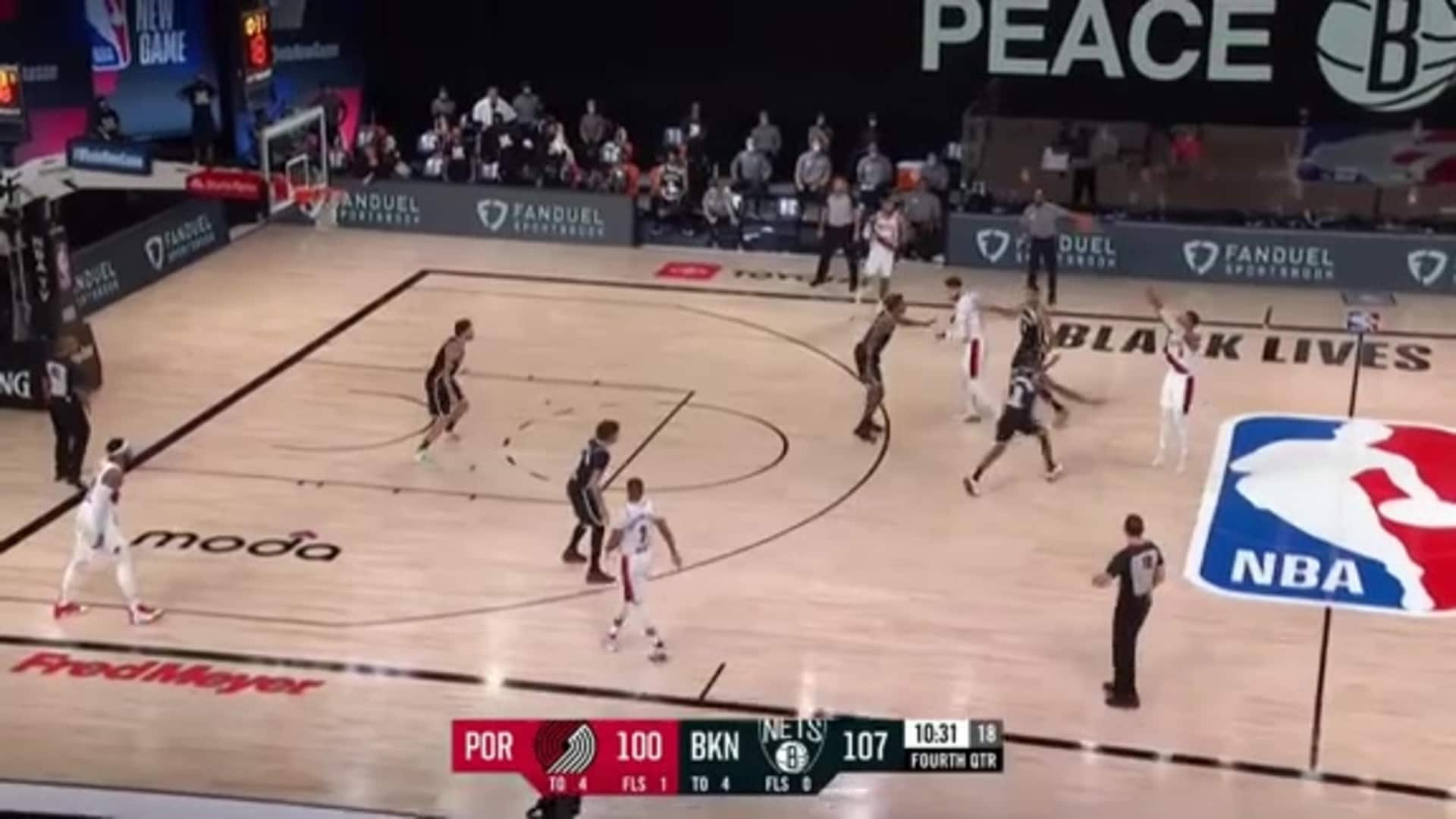 Damian Lillard hits the three from 35 feet away