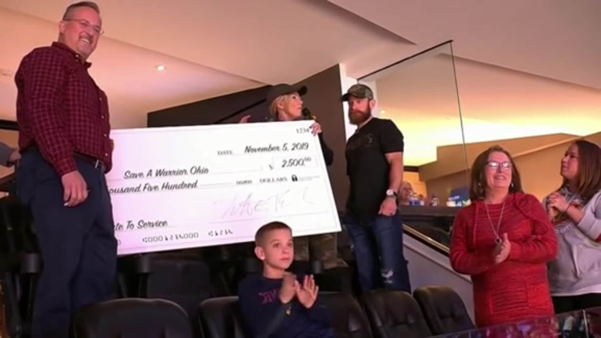 Ohio CAT Presents Micah Herndon with Check