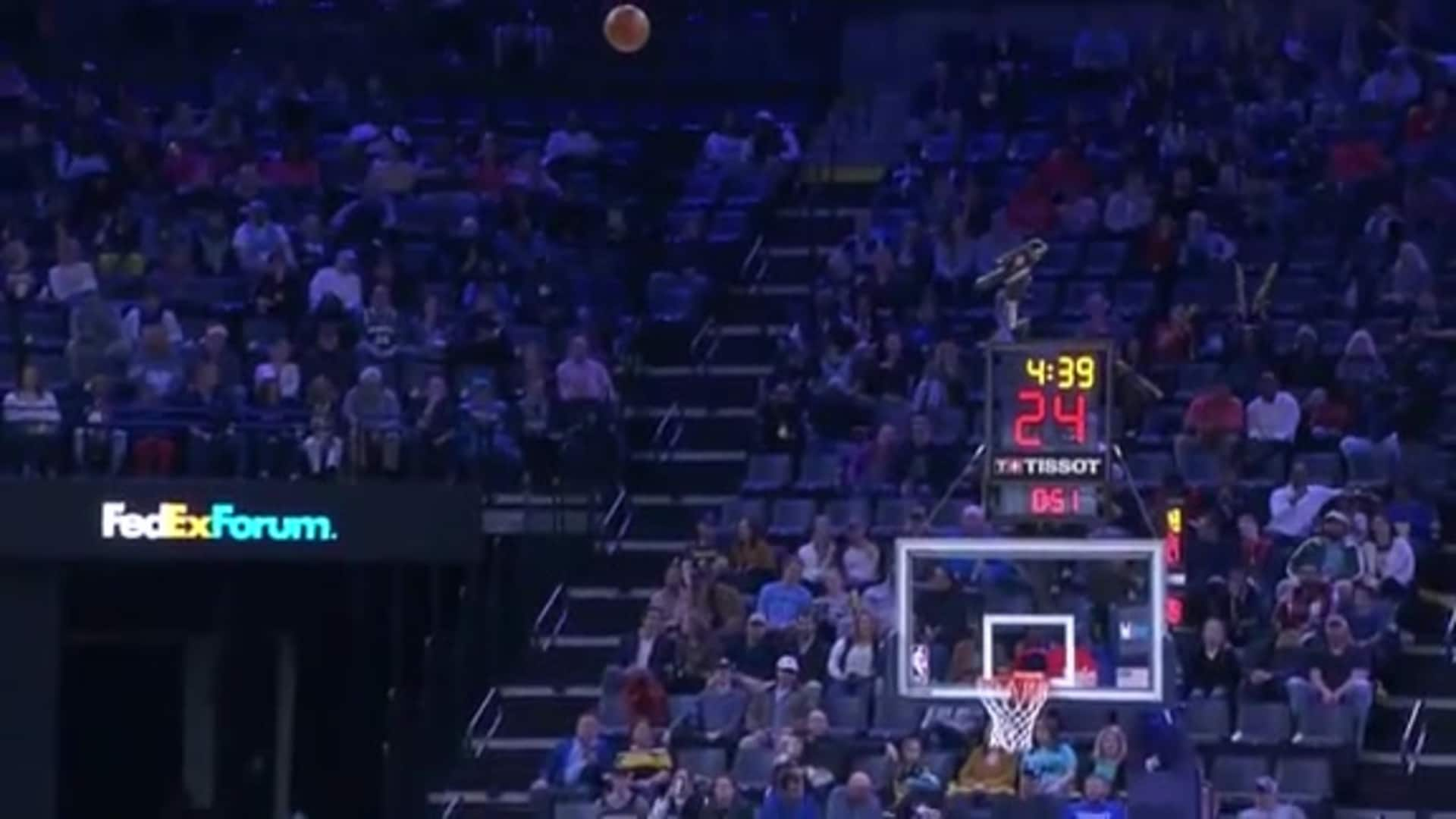 Grizz rainbows it in backwards from half court