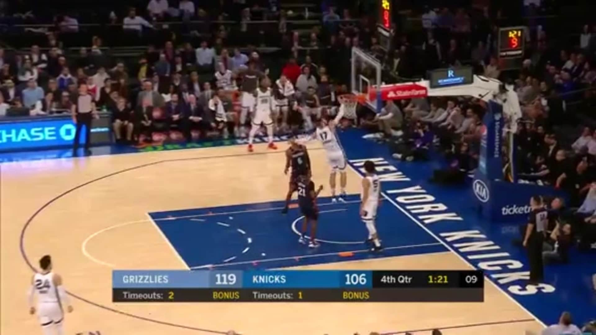 Jonas Valanciunas runs down the court for a towering dunk