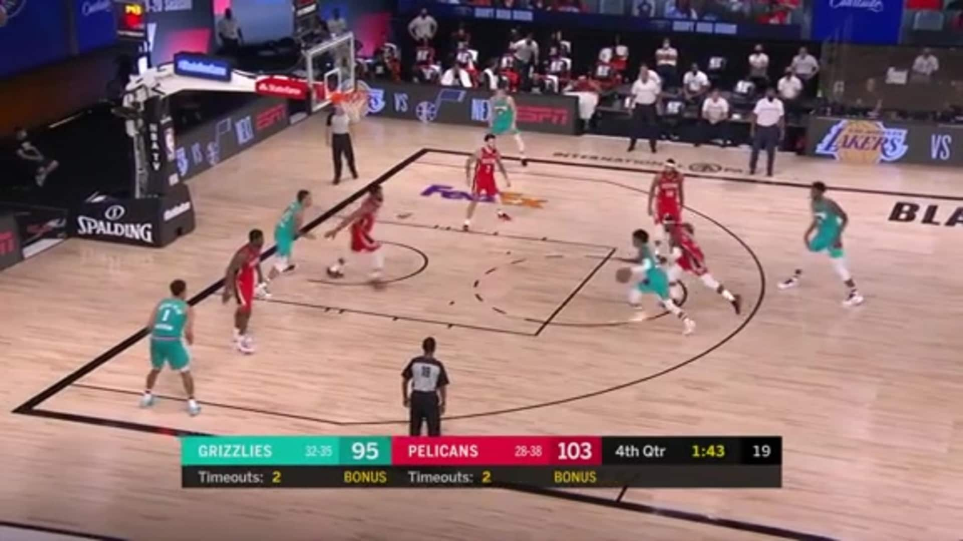 Ja Morant flies through traffic & finishes with a miraculous layup