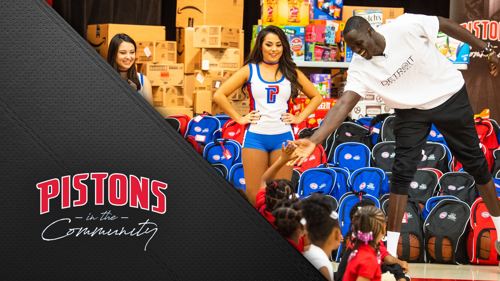 Pistons in the Community: Celebrating Mentoring Month