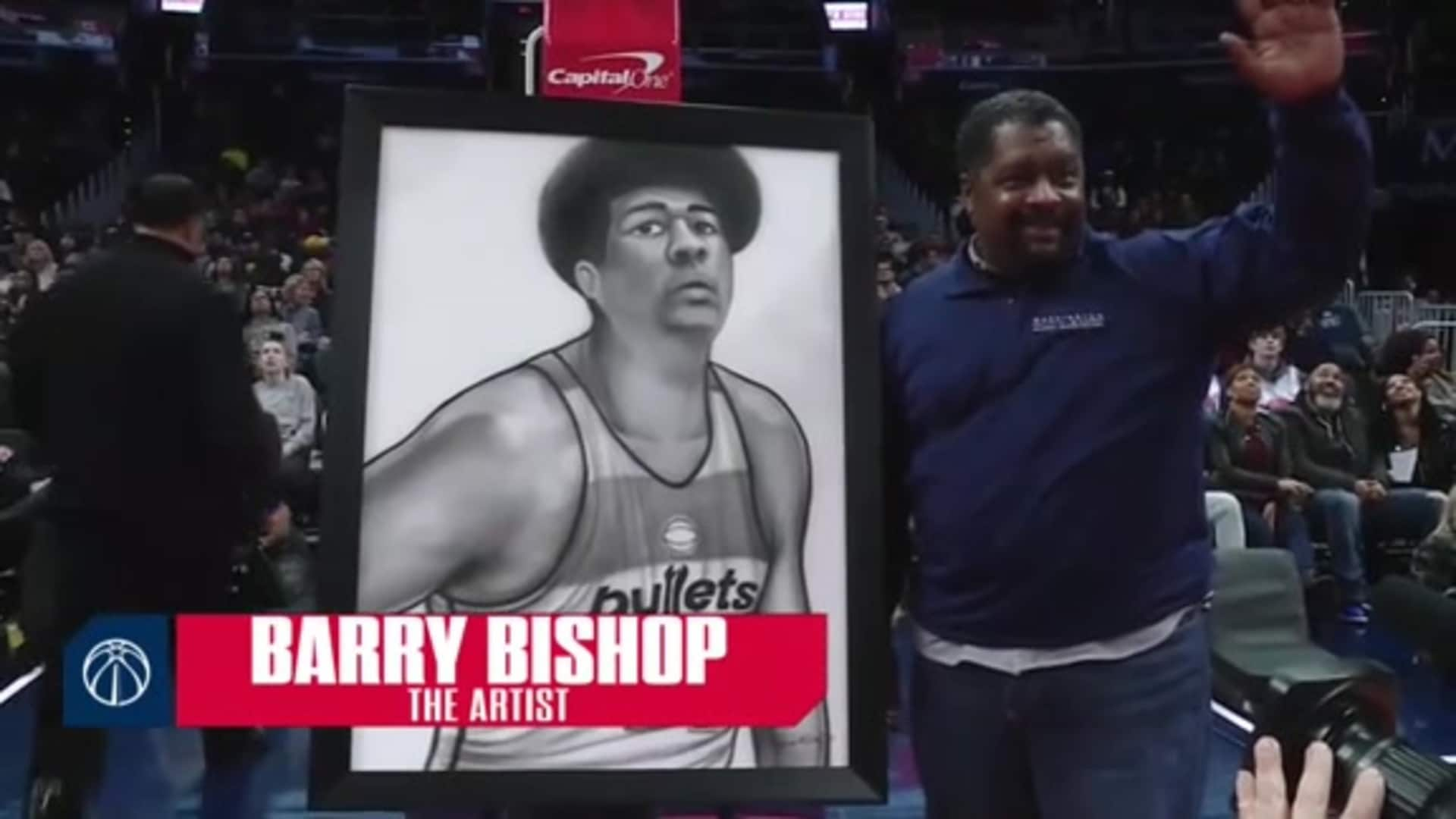 Barry Bishop displays Wes Unseld painting at Friday's game vs. Cleveland