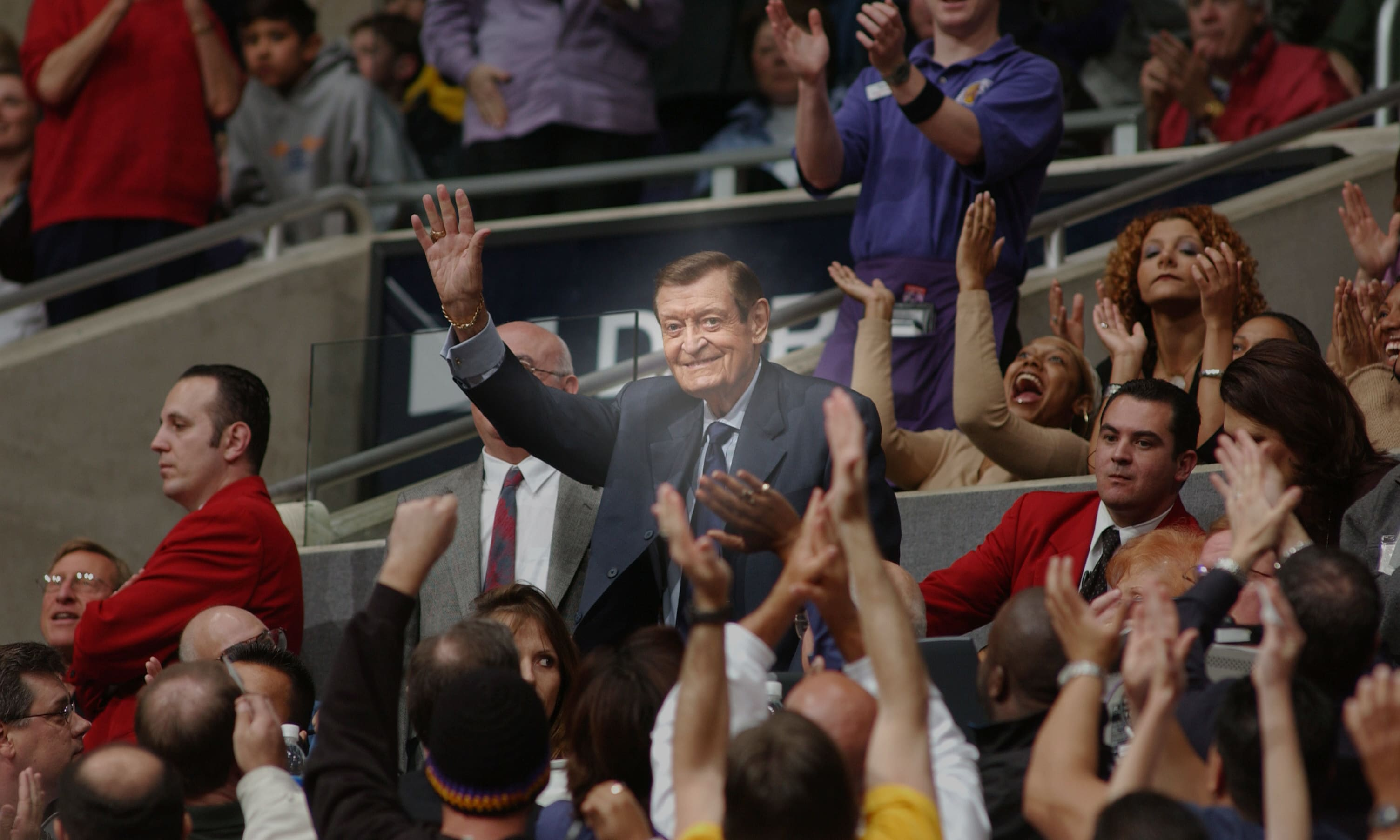 Chick Hearn waves at the crowd