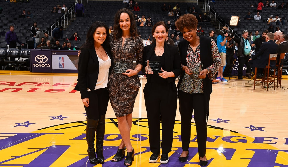 Rachel Rabizadeh (Comerica Bank Representative) along with Ashley Walsh Kvamme, Marsha Austen and Lisa Stockmon accepting the Comerica Bank Woman's Business Award for December 2016.