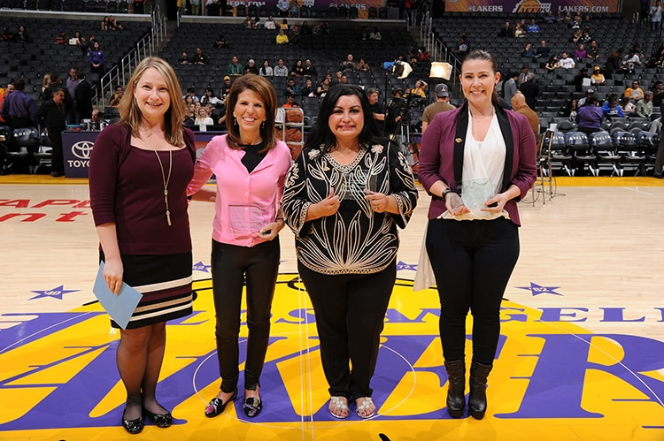 Stacy Phillips, Irma Resendez, and Laurel Mintz accepting the Comerica Women's Business Award for December.