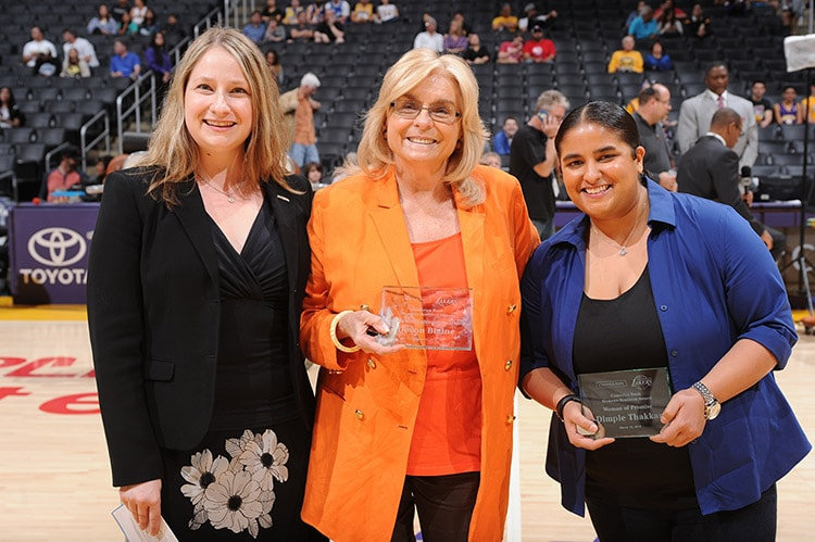 Devon Blaine(middle) and Dimple Thakkar(right) accepting the Comerica Women's Business Award for February from Evangeline Cumming(left).
