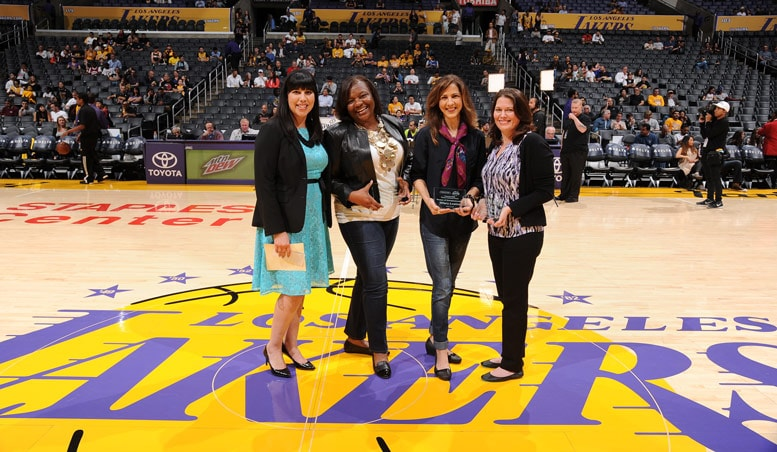 Jacqueline Vega (Comerica Representative), Britta Wilson, Hilary Lentini, and Carrie Cresante accepting the Comerica Women's Business Award for February.