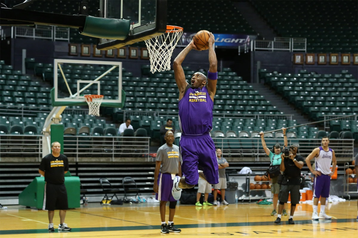 Kobe Bryant takes off for an in-scrimmage dunk at his final training camp at the University of Hawaii.