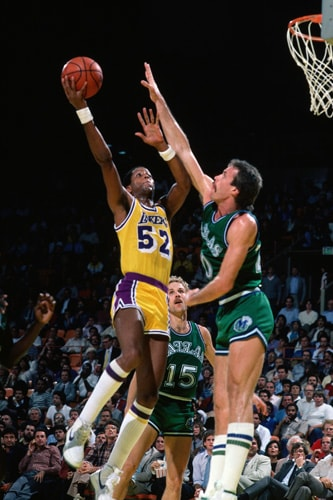 32bd70bd855 Jamaal Wilkes #52 of the Los Angeles Lakers goes for a layup against the  Dallas