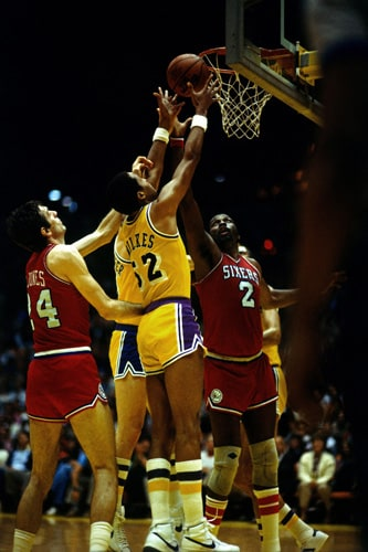 f471c12f44e Jamaal Wilkes #52 of the Los Angeles Lakers battles for the rebound against  Moses Malone