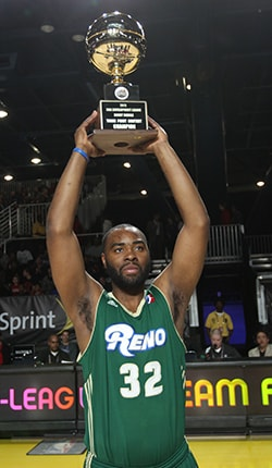 Marcus Landry of the Reno Bighorns celebrates with his trophy after winning the 3-point shooting contest during the NBA D-League Dream Factory at Jam Session during the NBA All-Star