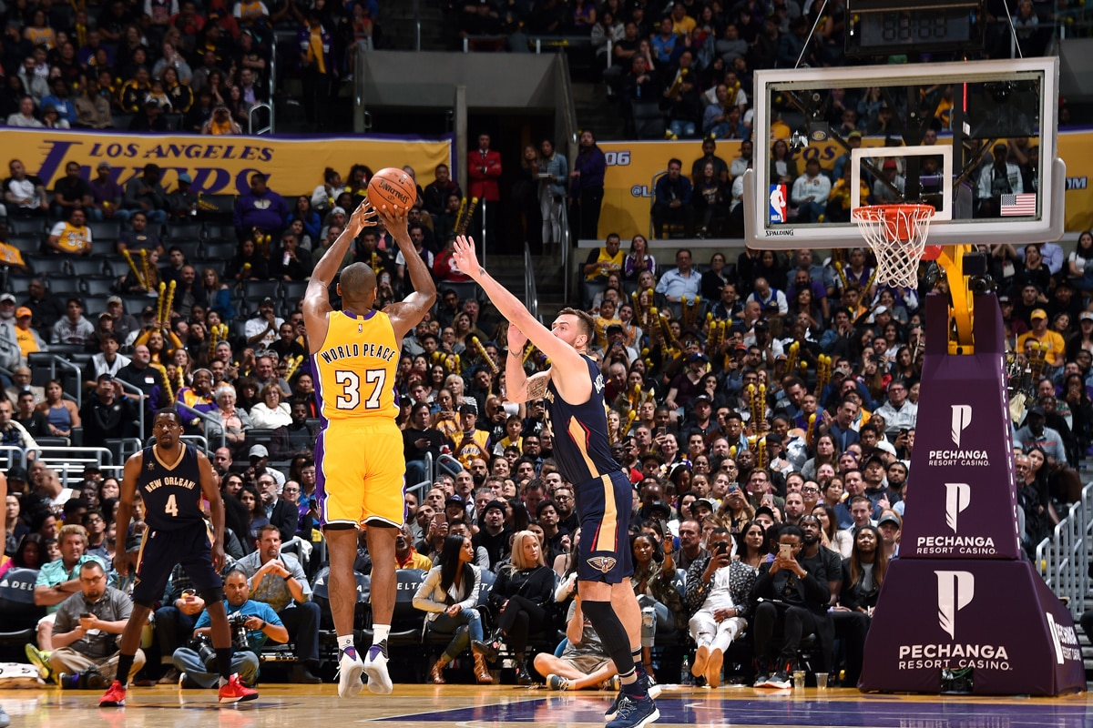 World Peace shooting one of the four successful three-pointers of his final home game as a Laker.