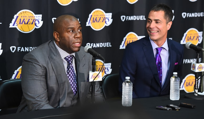 Magic Johnson sits alongside Rob Pelinka during his introductory press conference