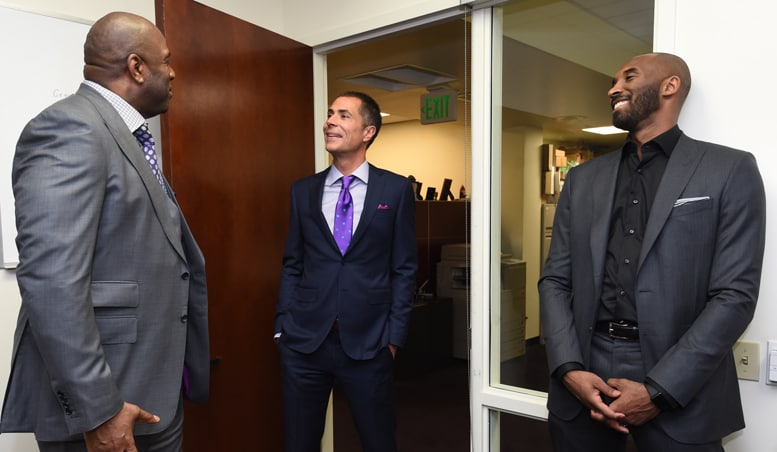 Earvin Magic Johnson, Rob Pelinka, and Kobe Bryant chat before Pelinka's introductory press conference