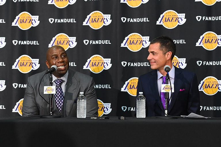 Pelinka sits with Magic Johnson during his introductory press conference