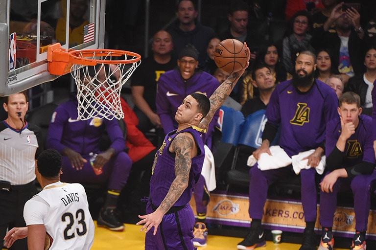 Kuzma rises for a dunk against New Orleans