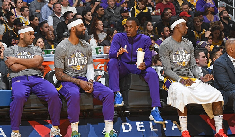 Rajon Rondo on bench with Dudley, Morris, and KCP