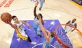 Jeremy Lin attempts a layup over the Denver Nuggets