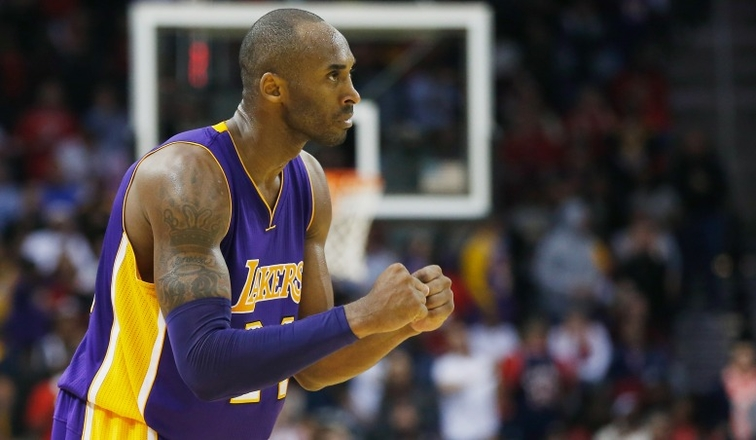 Kobe Bryant celebrates a play against the Houston Rockets on Nov. 19.