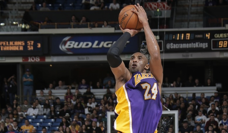 Kobe Bryant fires a shot in his last game against Sacramento on Dec. 21.