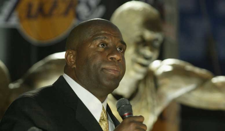 Magic returns to Lakers as adviser for Buss