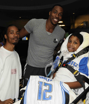 7129f97a7 Dwight Howard Lifts Local Boy s Spirits