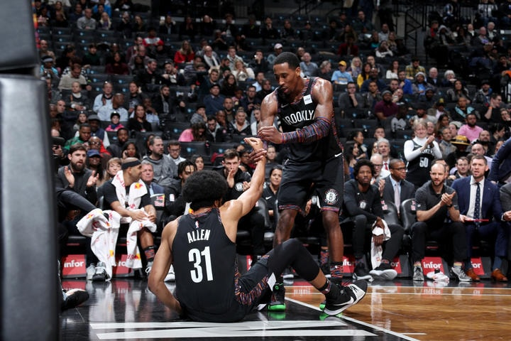 BROOKLYN, NY - NOVEMBER 30: Jarrett Allen #31 is helped up by Rondae Hollis-Jefferson #24 of the Brooklyn Nets during the game against the Memphis Grizzlies on November 30, 2018 at the Barclays Center in Brooklyn, New York. (Nathaniel S. Butler/NBAE via Getty Images)
