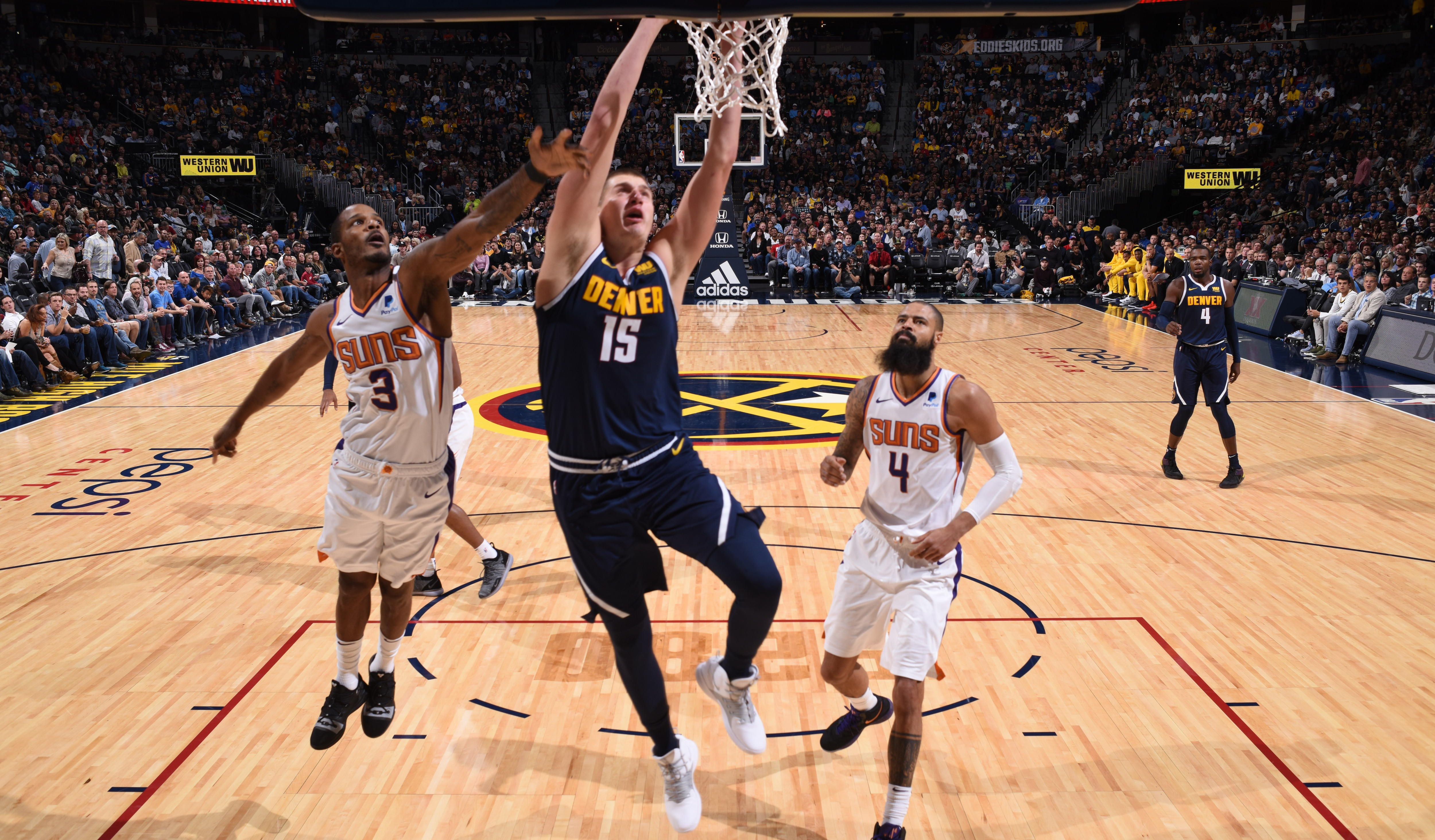 Jokic Records Triple-Double Nuggets Blow Out Suns in Home Opener