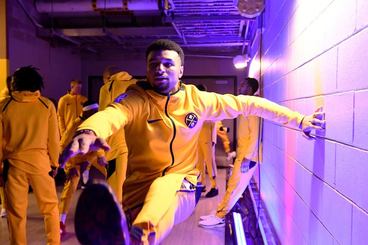 DENVER, CO - OCTOBER 21: Jamal Murray #27 of the Denver Nuggets stretches before the game against the Golden State Warriors on October 21, 2018 at the Pepsi Center in Denver, Colorado. (Garrett Ellwood/NBAE via Getty Images)