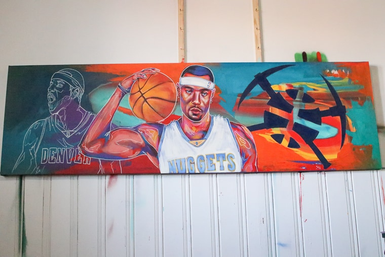 Artist, DeTour, paints a mural of Kenyon Martin for the Skyline Nights game on Jan. 19, 2019.
