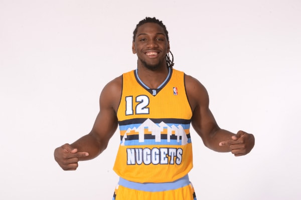 86d7d8343a0c Denver Nuggets forward Kenneth Faried models a prototype of the team s new  alternate jersey.(