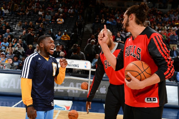 5856ff2926e Nuggets point guard Nate Robinson talks to former teammate Joakim Noah  before Denver s game against the