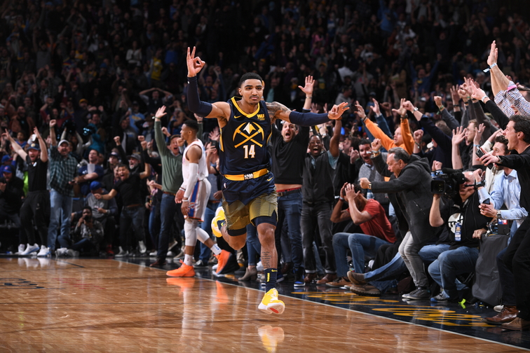 Gary Harris celebrating after hitting a game winner to beat OKC.
